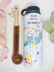 Environmentally friendly coconut fiber bristle scrub brush with wooden handle.