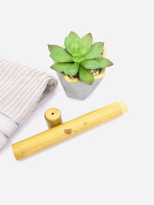 Sustainable bamboo toothbrush travel case.