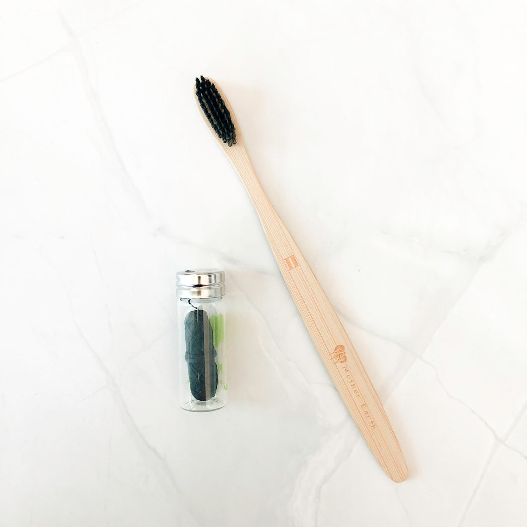 100% biodegradable charcoal dental floss with all-natural charcoal bamboo toothbrush.