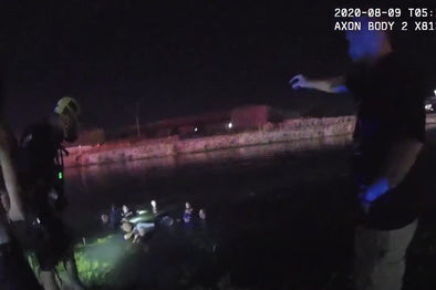 Police officers and firefighters jump into canal to save children from sinking vehicle