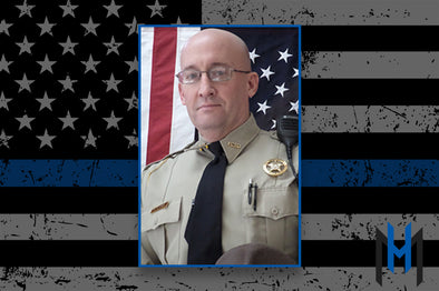 Deputy killed while investigating a traffic crash.