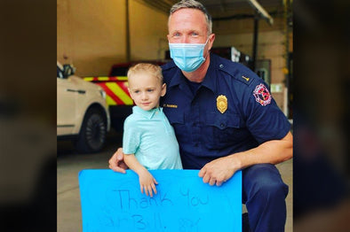 Firefighter saves boy who is found face down in a pool and not breathing.