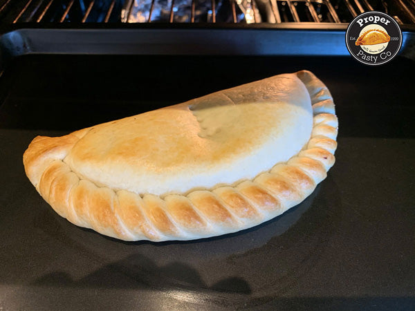 Turn pasty for even bake after 20 mins