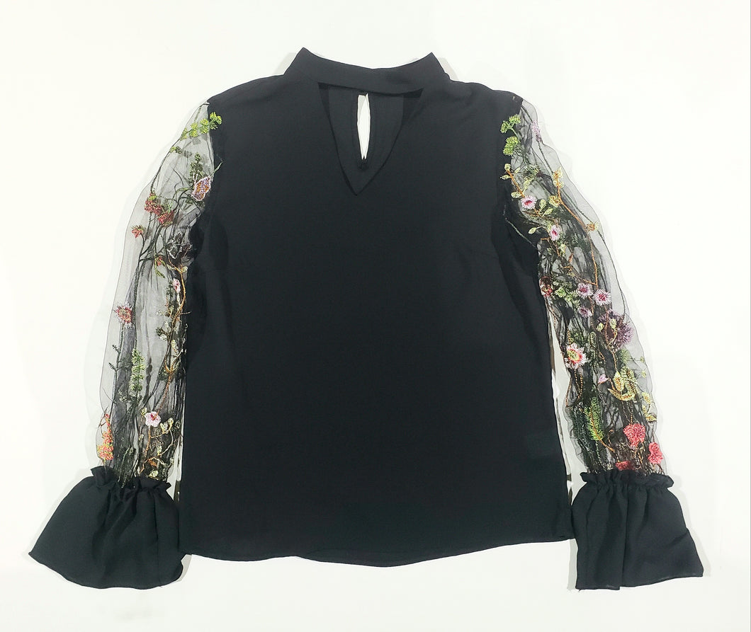 black blouse with sheer floral sleeves