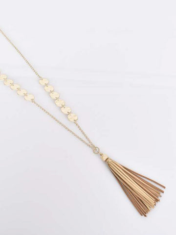 Long metal disc and tassel necklace in gold