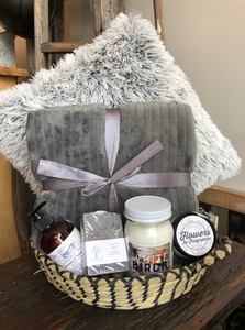 The perfect cozy basket with a soft throw, toss cushion, locally made candle, body butter, wash and soap.