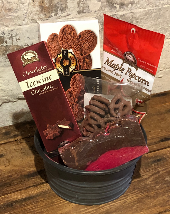 Valentine's Day basket with cookies, maple popcorn, chocolate pretzels, fudge and ice wine chocolates.