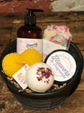 Locally made bar soap, bathbomb and body butter with a hand poured beeswax candle.