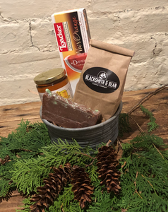 This coffee break basket includes locally roasted Fairtrade coffee, fudge, honey, flavoured tea and cookies.