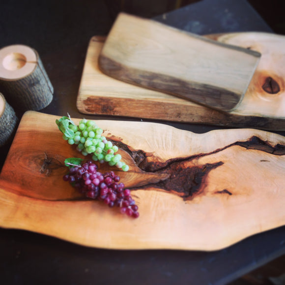 Rustic Charcuterie boards made from logs recovered from the bottom of Ontario lakes.