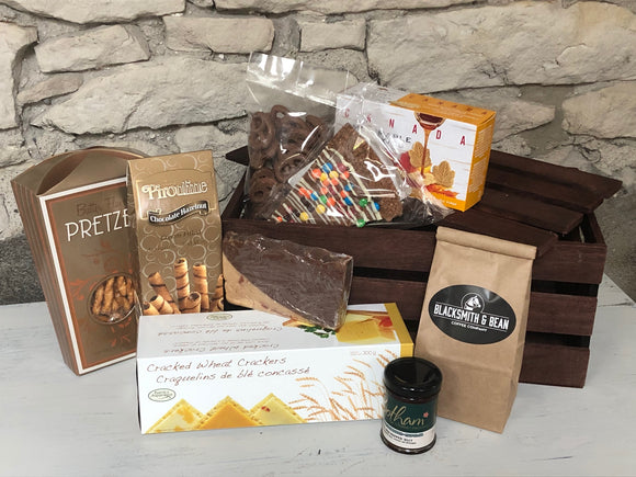 This gift is designed for sending to those outside the local Guelph area.  Gourmet treats are boxed in an attractive wooden crate. Local crackers and chutney, chocolate pretzels, fudge, chocolate pizza, locally roasted coffee, cookies and more.