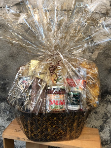 Hostess Gift Basket makes a great gift when visiting friends or family. Local tortilla chips, salsa, crackers and red pepper jelly, fudge, tea and more.