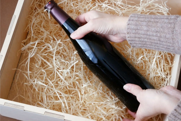 Wine bottle inside a delivery box