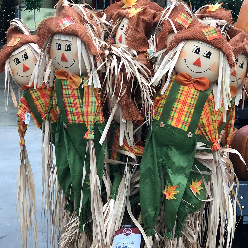 display of life-size scarecrow decorations
