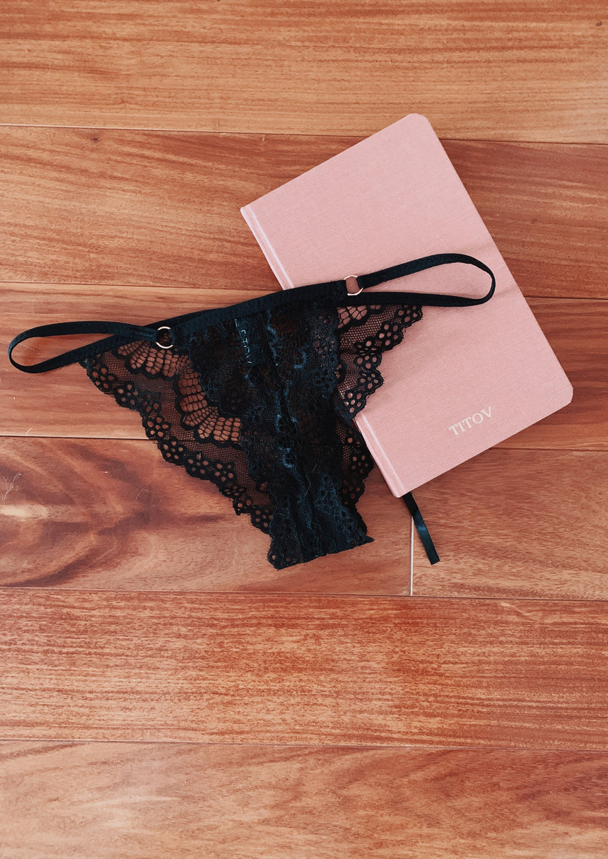 Black lace thong with notebook