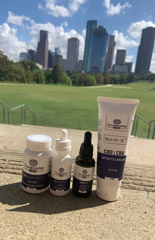 Juvenate CBD products. CBD Oil Tincture, CBD Face Serum, CBD Softgels, and CBD/CBG Sports Cream taken in Houston, Texas.