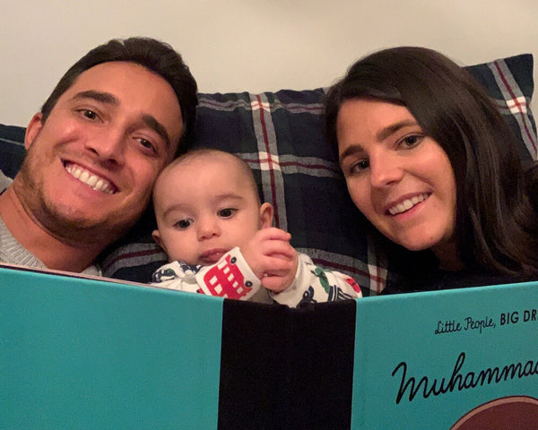 Parents reading a book to their baby