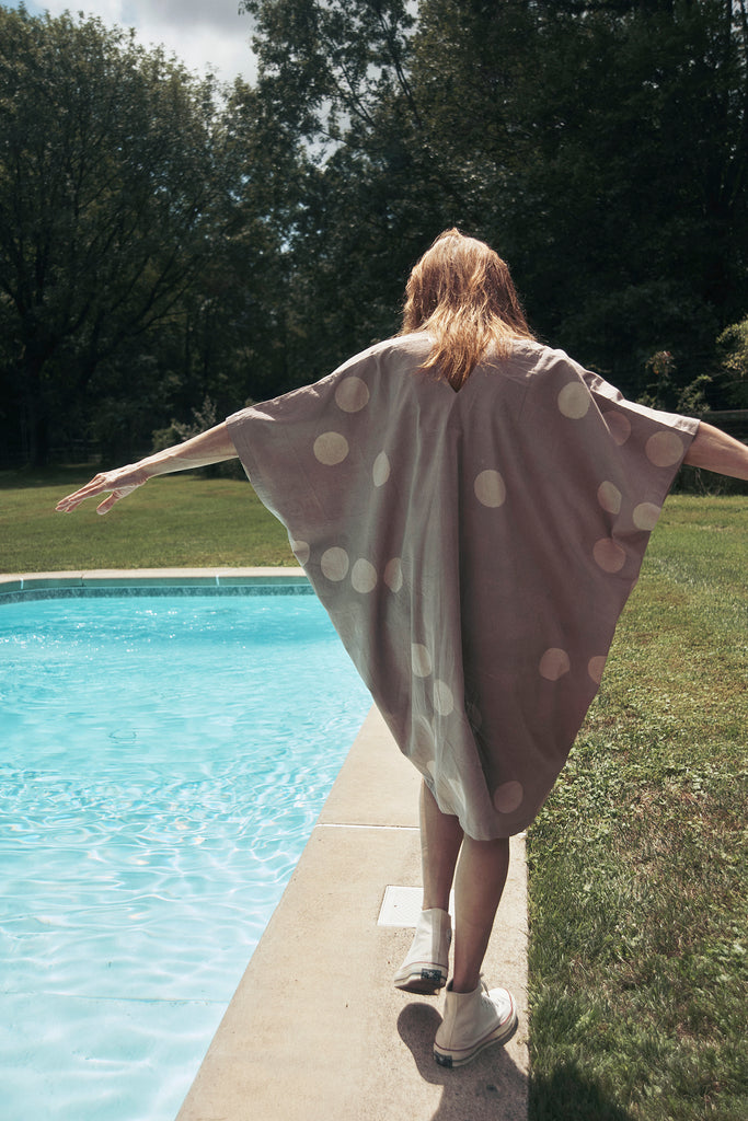 Woman in petal and white polka dot Caftan, Kaftan, Leisurewear, Genderless fashion, Sustainable fashion, Summer dress, Resortwear