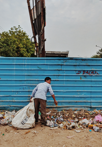 man cleaning up plastic trash
