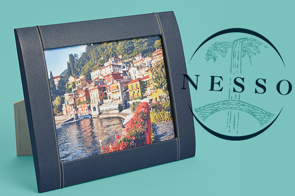 Picture of one of Nesso's leather picture frames, perfect for gifting, with the Nesso logo behind it