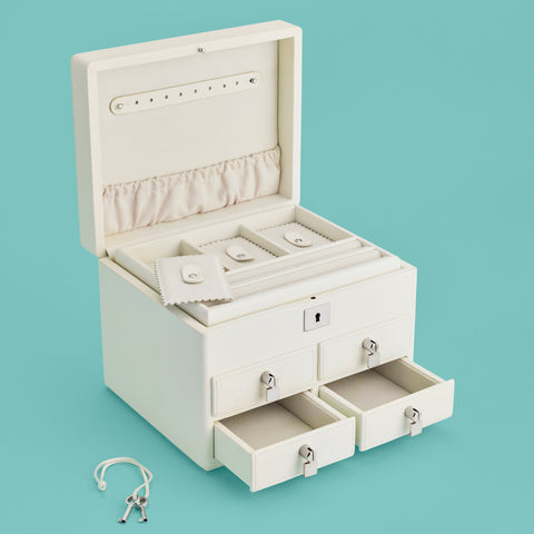 Cream leather jewelry box, shown with 4 drawers, shown opened