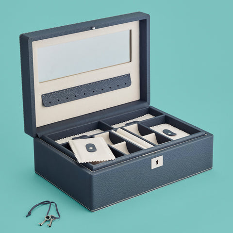 Navy blue leather jewelry box with mirror, shown open with lock and key