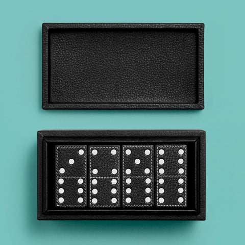Black leather domino game set, shown open with tiles