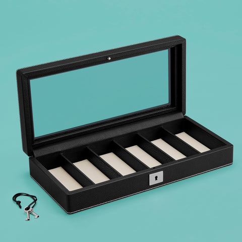 Black leather watch case, shown open with compartments for 6 watches and glass top