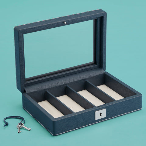 Navy leather watch case, shown open to show space for 4 watches and lock and key
