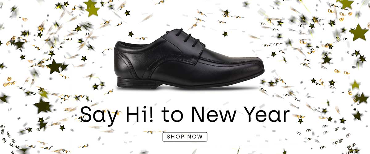 Fin boys lace up shoe on new years background