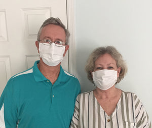 Candice Barry and her husband are shown in the image wearing Luosh American Made Face Masks. The look satisfied with their fit and feel. She comments that I ordered masks from you and loved them so much that I ordered another box for my elderly parents.