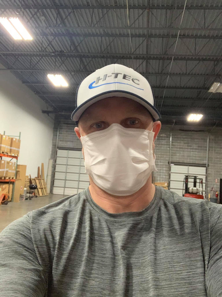Image of Chris Glass of Marietta Georgia wearing a Luosh American Made Face Masks in his workplace.  He comments that the mask is comfortable, professional, and a great value.