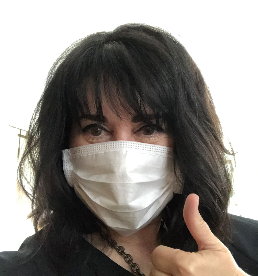 "Image of Colleen Abrie wearing a Luosh American Made face masks.  She is giving the mask a thumb's up to signal satisfaction with her purchase of the high quality masks. She comments ""If you gotta wear one, wear Luosh USA made."""