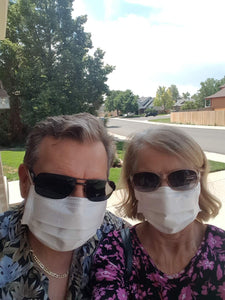 Image of Ricky and Cindy J. wearing Luosh American Made Face Masks outdoors.