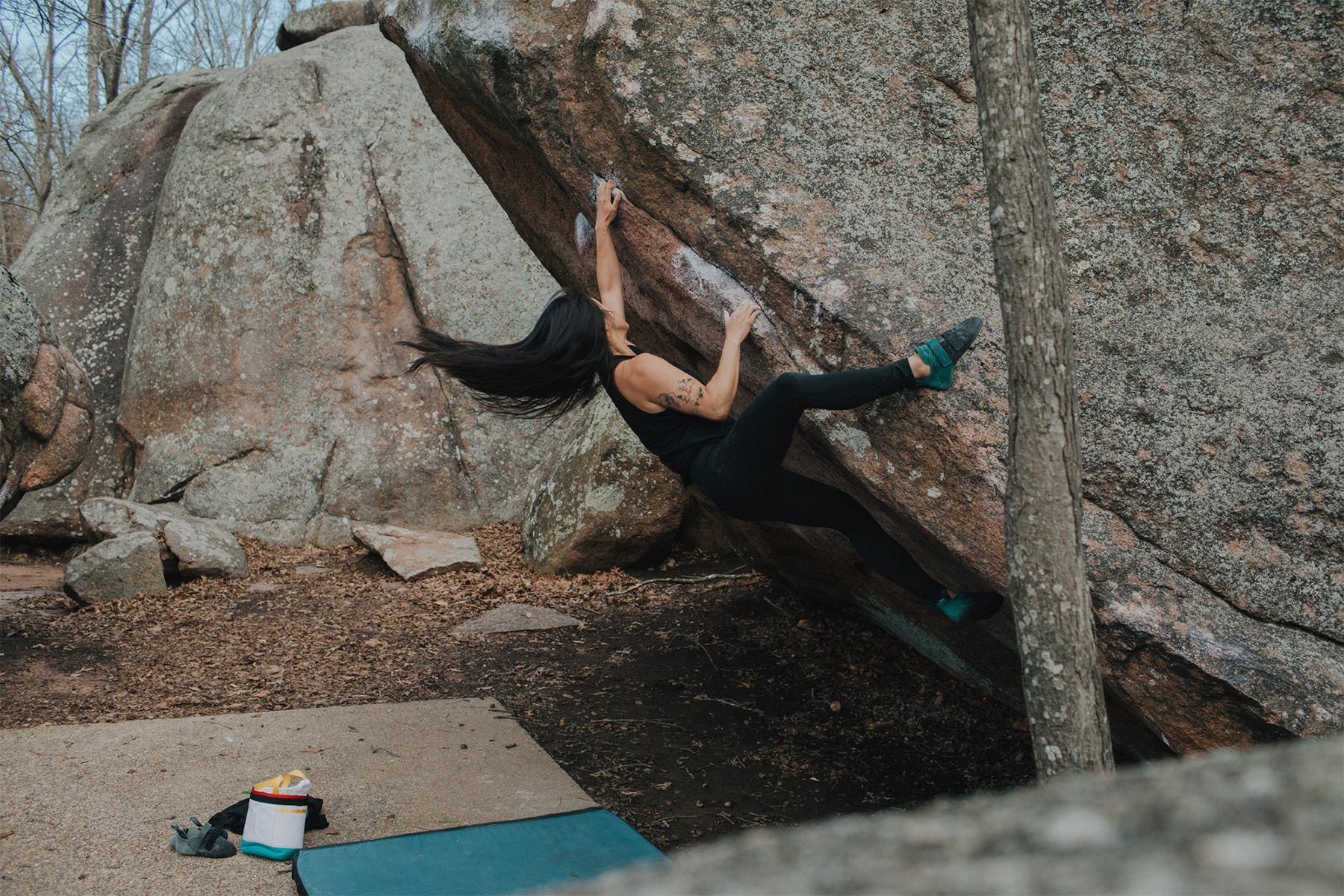 a woman climbs at Elephant Rocks in the REI So iLL collaboration rock climbing shoe the main street lv