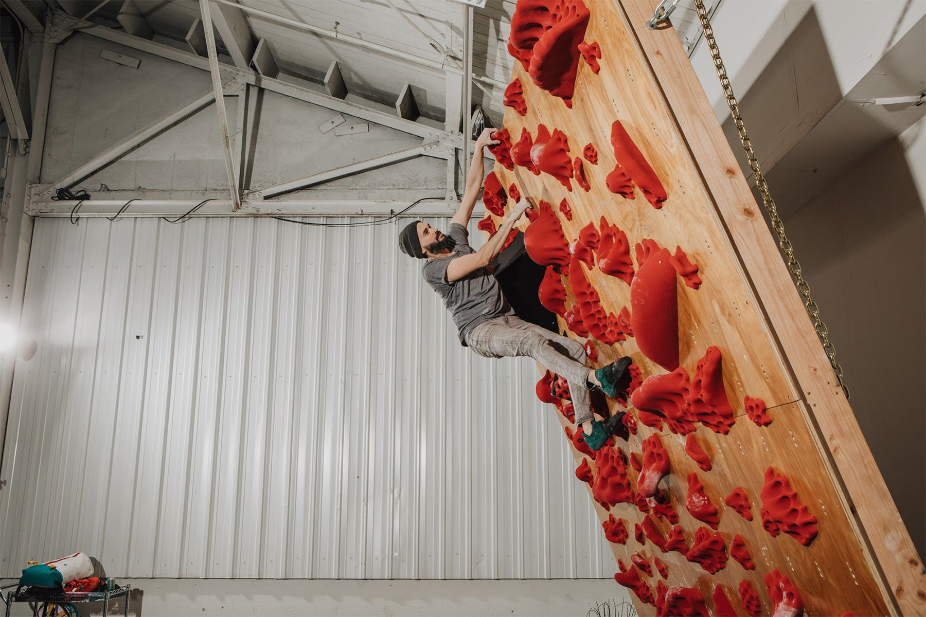 a man climbs at in the REI So iLL collaboration rock climbing shoe the main street lv