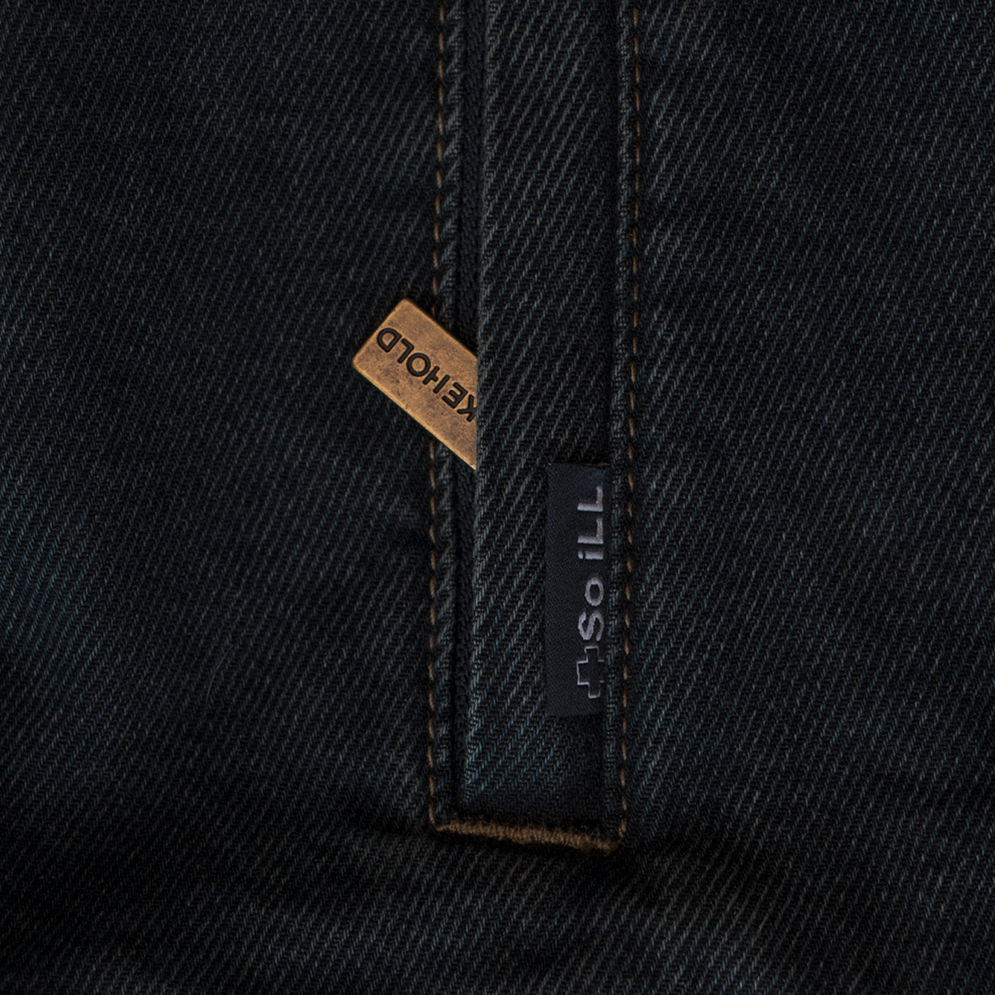 a close shot of the metal zipper on the so ill unisex denim jacket