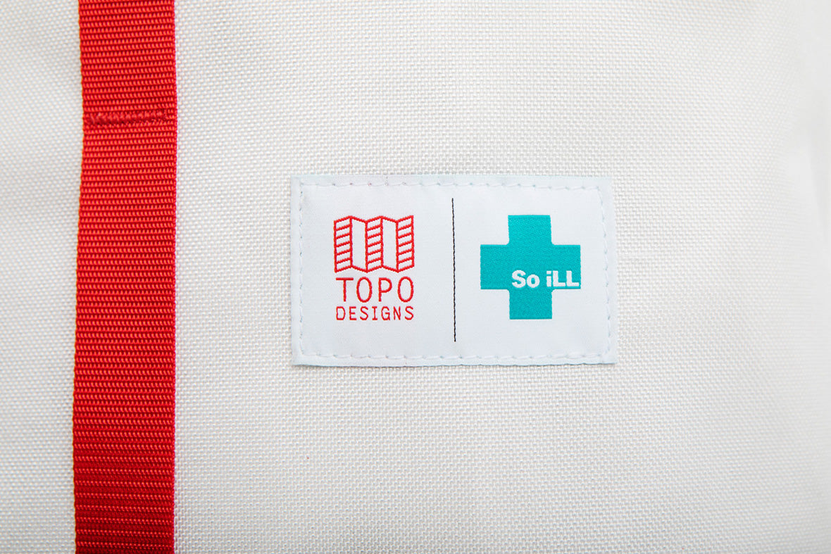 the topo x so ill cosmos bag is shown up close on the badge