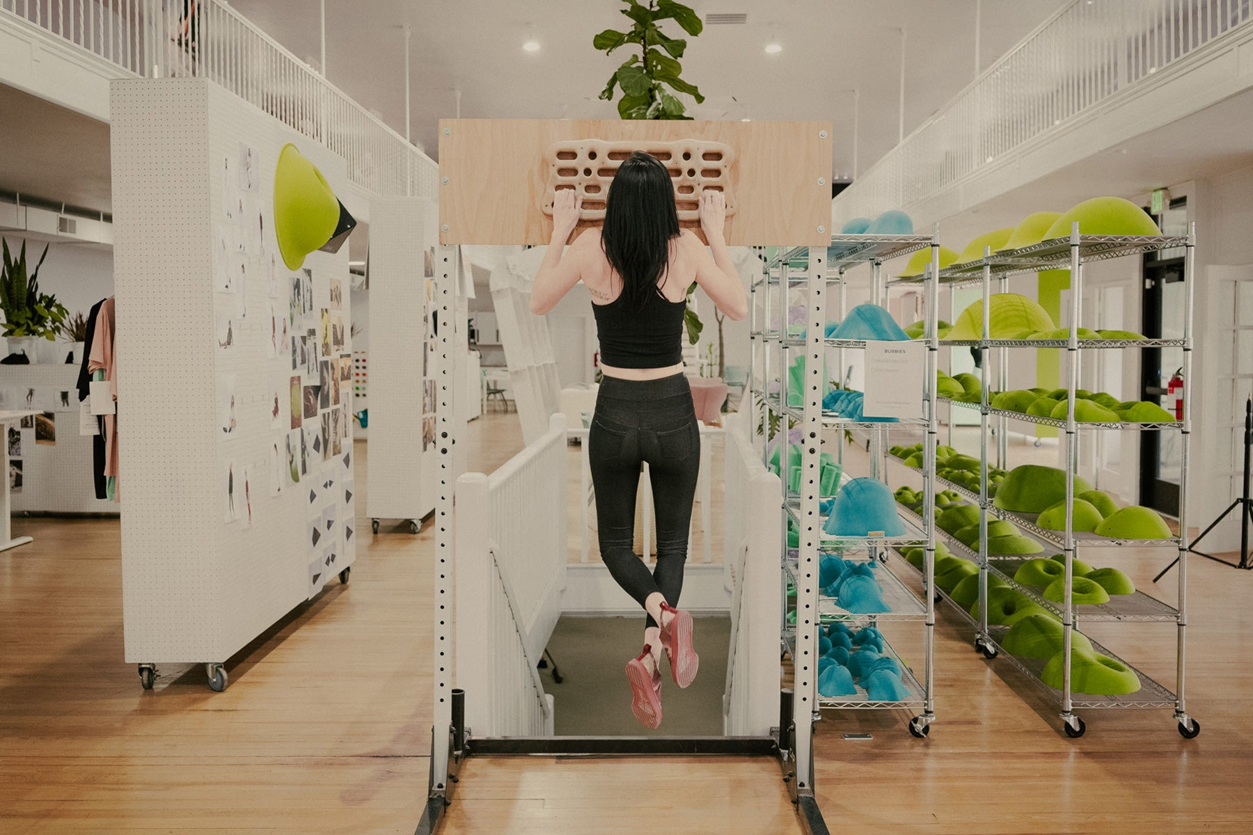 a woman trains on the so ill wood boost board inside of the so iLL headquarters