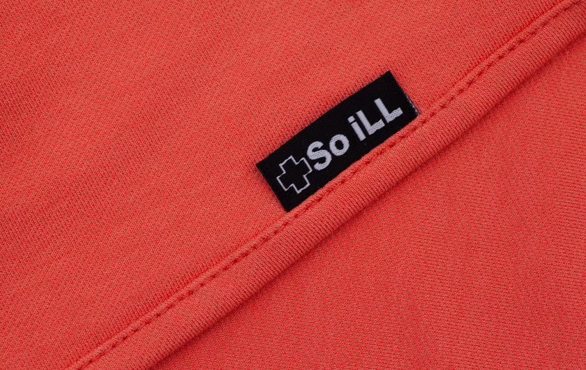 close up of tag of Coral Colored So iLL Active Jeans