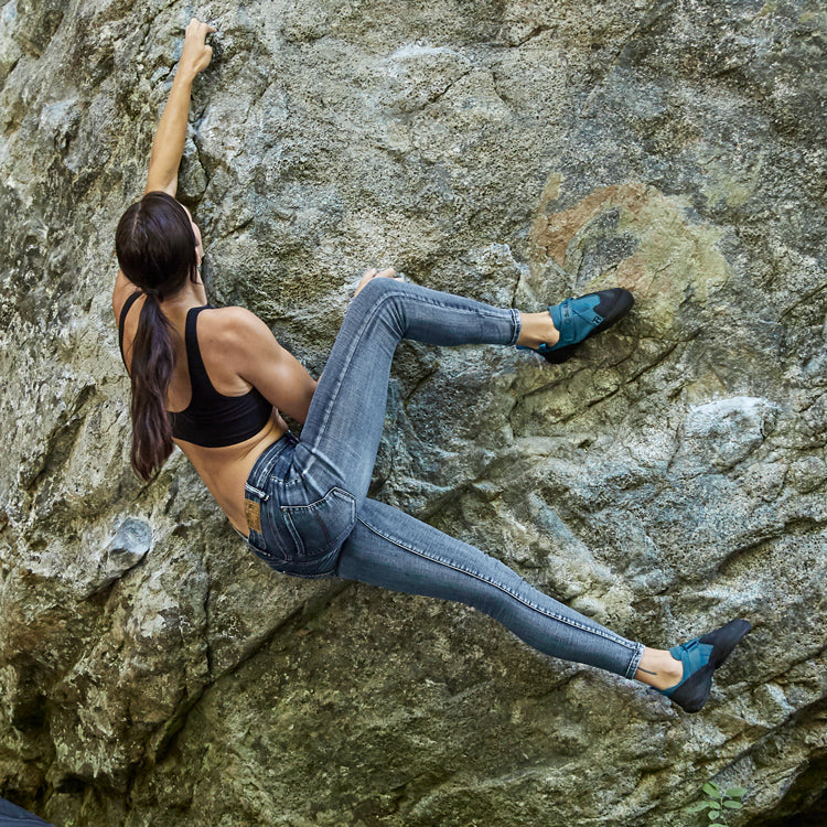 So iLL womens vintage wash climbing jeans being climbed in outside