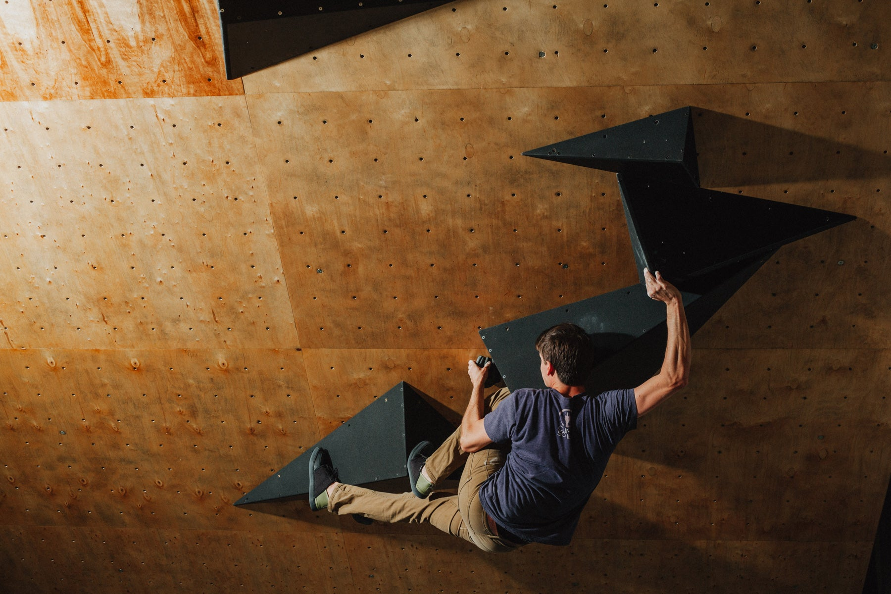 The So iLL flat pack volumes are climbed on during a climbing session.