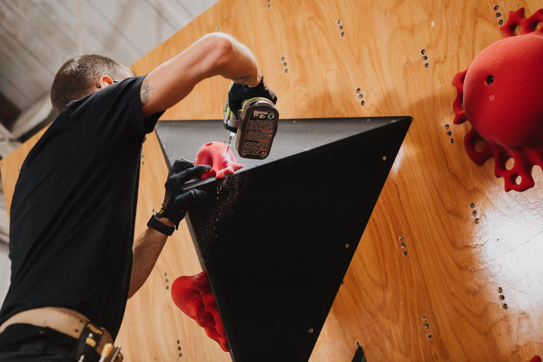 a climbing hold is screwed onto a so ill flat pack volume