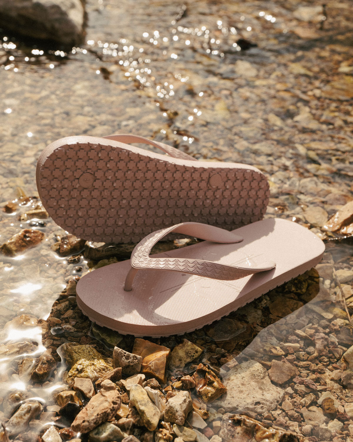 dirty pink on the roam x so ill kanaka sandals in a creek