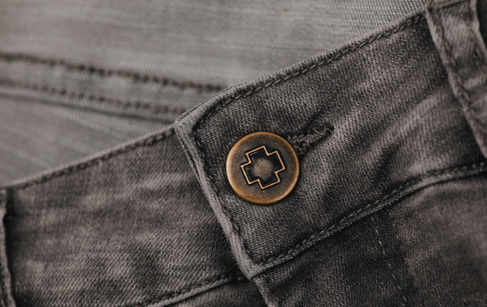 metalwork detail of So iLL Grey Denim Climbing Jeans