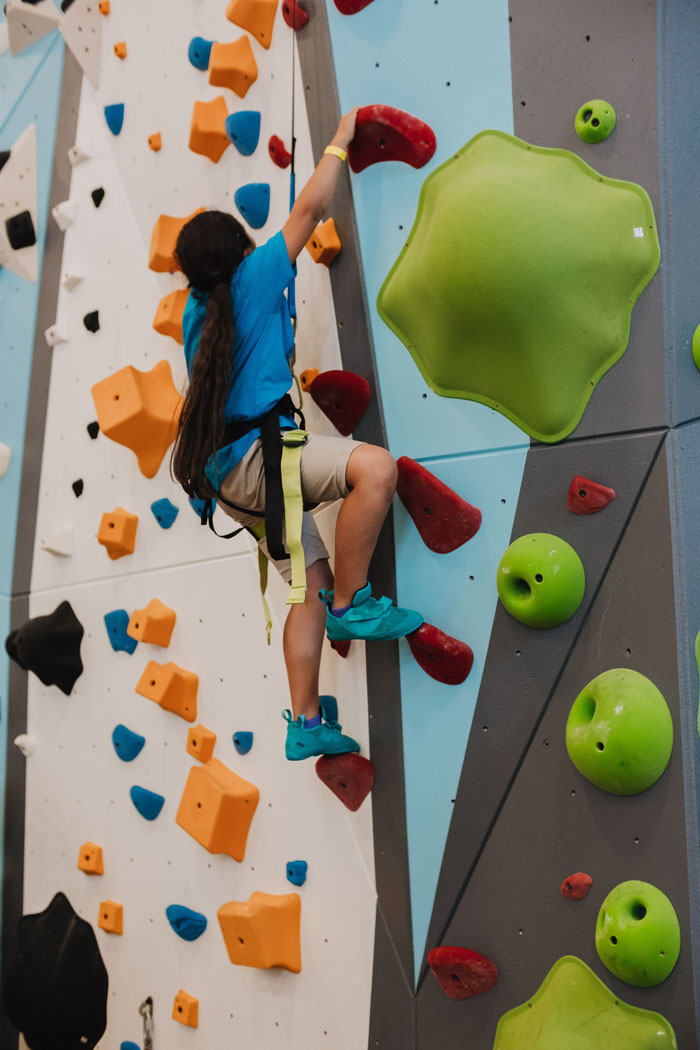 a girl climbs at the boys and girls club in la