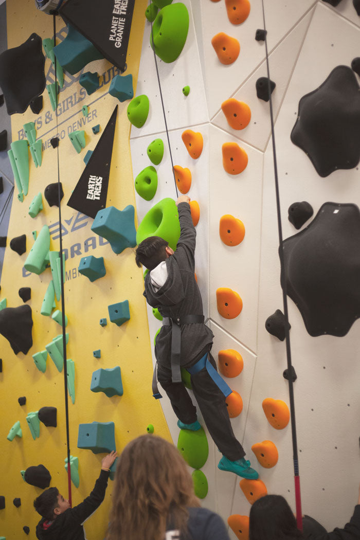 a boy climbs at the boys and girls club in denver