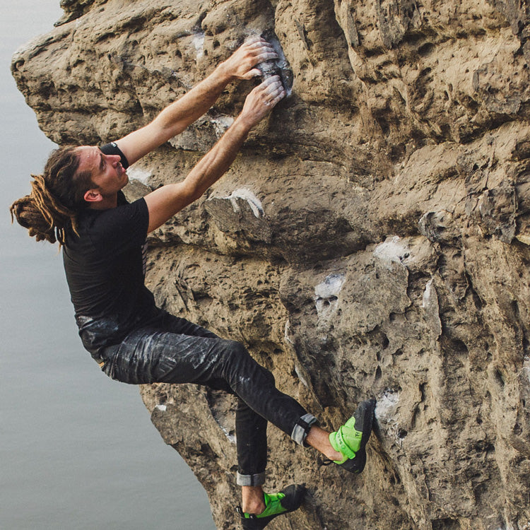 So iLL black denim climbing pants shown on man bouldering