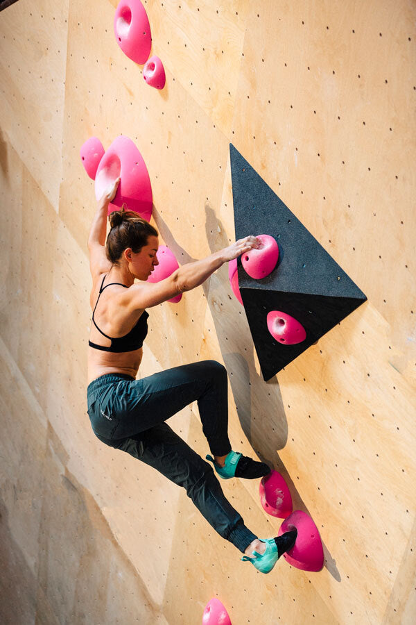 So iLL Street LV being climbed in by a woman at a bouldering gym