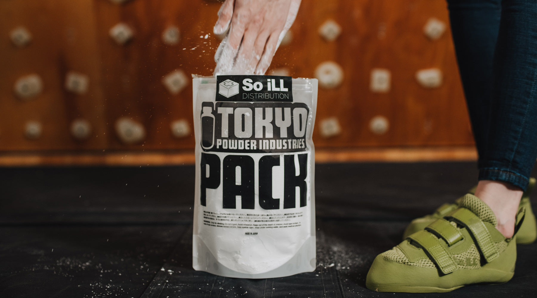 hands going into a bag of So iLL Tokyo Powder pure